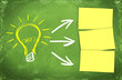 big light bulb as and idea symbol and postits