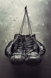 old boxing gloves hang on nail - 50165107