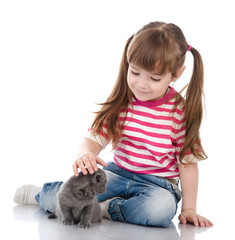 Baby girl with british kitten cat. isolated on white