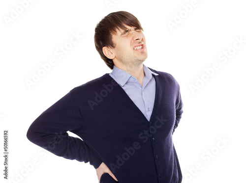 Young man with a backache isolated on white
