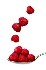 Raspberries on a spoon isolated on a white background