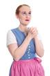 Bayerisches Mädchen isoliert im Dirndl betet