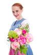 Junge Frau im Dirndl mit Blumenstrauß