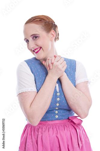 Junge Frau isoliert im Dirndl - überglücklich lachend