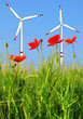wind turbines in wheat field with red poppies