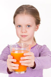 Young girl drinking orange juice - healthy life