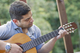 Hispanic man playing guitar