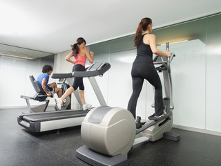 People using gym exercise equipment