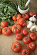 Tomatoes, garlic and basil on cutting board