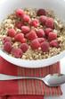 Fresh raspberries in bowl granola cereal
