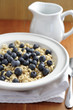 Fresh blueberries in bowl of cereal