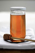 Honey in jar with dripper