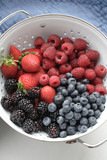 Various fresh berries in colander