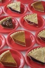 Variety of slices of pie on plates
