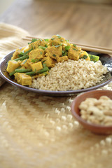 Curry soy tempeh and rice in bowl
