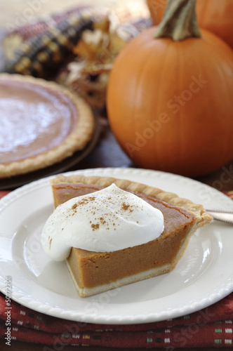 Fresh, homemade pumpkin pie with whipped cream