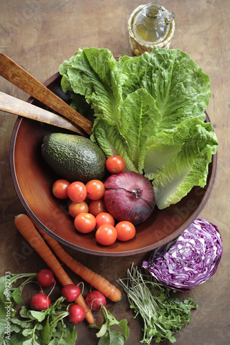 Fresh vegetables in wooden bowl