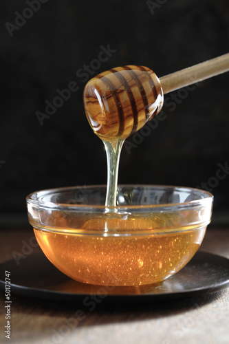 Honey dripping off of dipper