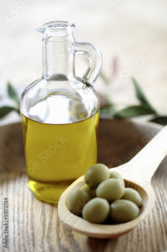 Olives and olive oil in jug