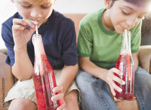 Boys drinking soda together