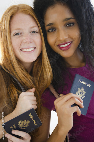 Friends standing with passports