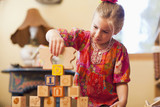 Caucasian girl stacking blocks
