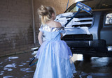 Caucasian girl in costume washing car