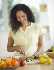 Hispanic woman chopping vegetables