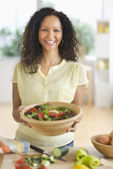 Hispanic woman preparing salad