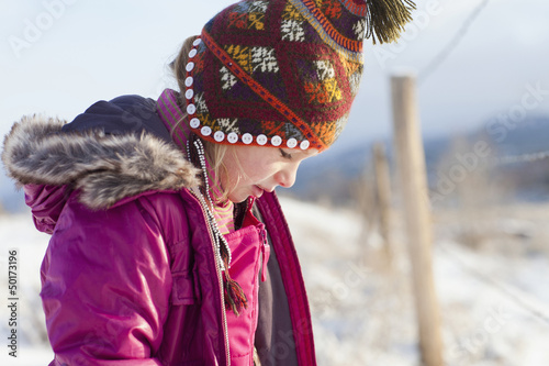 Caucasian girl in cap and coat outdoors