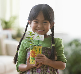 Asian girl holding mint plant