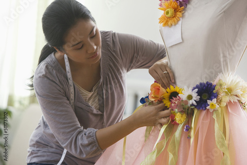 Asian woman designing clothing