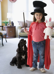 Caucasian girl dressed in magician's costume