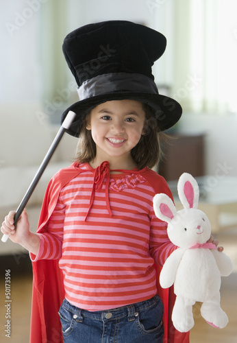 Caucasian girl dressed in magician's costume
