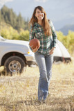 Caucasian woman holding football