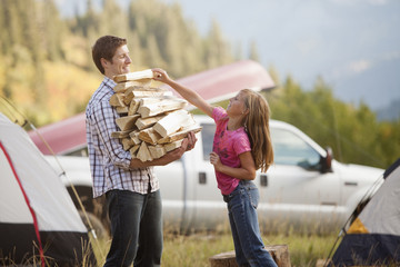Caucasian father and daughter gathering firewood