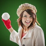Mixed race woman throwing snowball