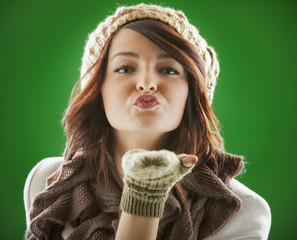 Mixed race woman blowing kisses