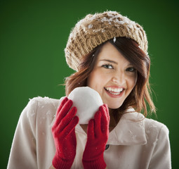 Mixed race woman holding snowball