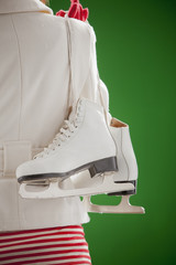 Mixed race woman carrying ice skates