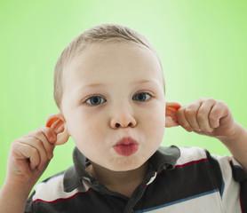Caucasian boy pulling his ears