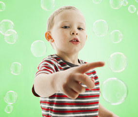 Caucasian boy popping bubbles