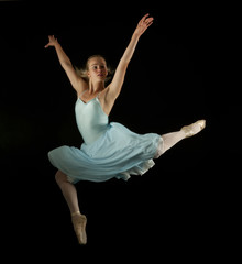 Caucasian ballet dancer in mid-air