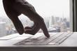 Mixed race man typing on laptop