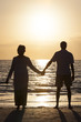 Senior Couple Holding Hands Sunset Tropical Beach