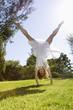 Woman doing cartwheel in park