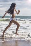 Sexy Woman Girl in Bikini Running on Beach