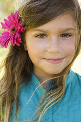 Smiling girl with flower in her hair
