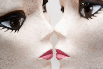 Female mannequin heads kissing