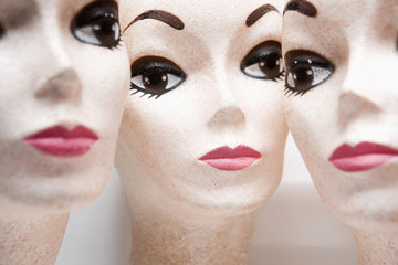 Three female mannequin heads